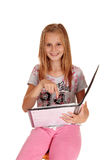 Schoolgirl pointing at her book. Stock Image