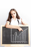 Schoolgirl pointing to line graph Stock Photos