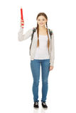 Schoolgirl pointing up with pencil. Stock Images