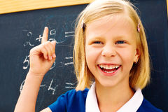 Schoolgirl ponders solving a mathematical problem Stock Photo