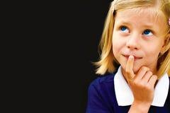 Schoolgirl ponders solving a mathematical problem Stock Photos