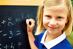 Schoolgirl ponders solving a mathematical problem Stock Images