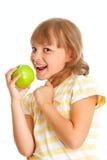 Schoolgirl portrait eating green apple isolated Stock Photography