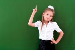 Schoolgirl portrait near the blackboards Stock Photography