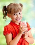 Schoolgirl portrait with water glass Stock Photo