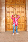 Schoolgirl posing before big wooden door Stock Image