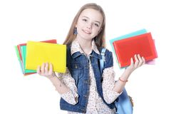 Schoolgirl posing with books isolated on white background royalty free stock photography