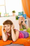 Schoolgirl posing on couch Royalty Free Stock Photography