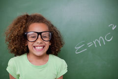 Schoolgirl posing with the the mass-energy equivalence formula Stock Photos