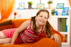 Schoolgirl posing on sofa at home Royalty Free Stock Photo
