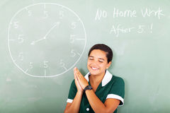 Schoolgirl praying homework Royalty Free Stock Images
