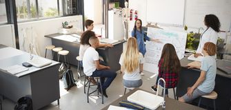 Schoolgirl presenting in front of science class, high angle Stock Image