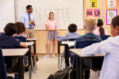 Schoolgirl presenting to her elementary school classmates Royalty Free Stock Photo