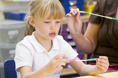 A schoolgirl in a primary class Royalty Free Stock Image