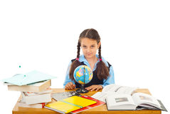 Schoolgirl at pupil with world globe Stock Images