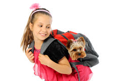 Schoolgirl with puppy Royalty Free Stock Photography