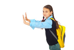 Schoolgirl pushing wall Royalty Free Stock Photography