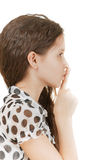 Schoolgirl puts finger to lips Royalty Free Stock Photos