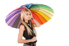 Schoolgirl and rainbow umbrella Stock Photos