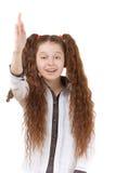 Schoolgirl raises her hand Royalty Free Stock Images
