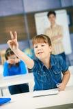 Schoolgirl raising hand Royalty Free Stock Image