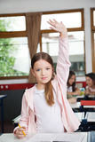 Schoolgirl Raising Hand While Standing In Royalty Free Stock Photography