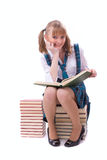 Schoolgirl is reading. Stock Photography