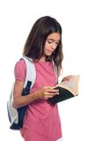 Schoolgirl reading Royalty Free Stock Images