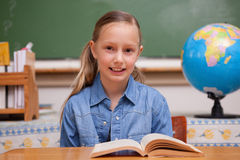 Schoolgirl Reading A Book Royalty Free Stock Photo