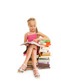 Schoolgirl reading a book Stock Photos