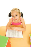 Schoolgirl reading a book Stock Image