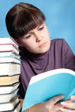 Schoolgirl reading book Stock Photography