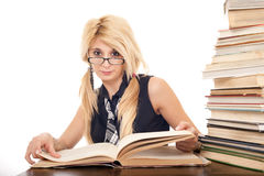 Schoolgirl reading book Stock Photography