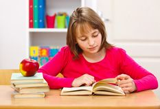Schoolgirl reading book Royalty Free Stock Image