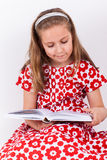 Schoolgirl reading book Stock Photo