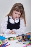 Schoolgirl reading a book Royalty Free Stock Photos