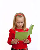 Schoolgirl reading Royalty Free Stock Photo