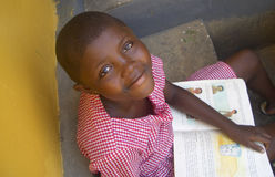 Schoolgirl reading a book in Ghana royalty free stock photo