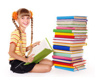 Schoolgirl reading pile of books. Royalty Free Stock Image