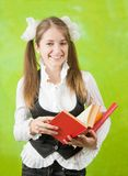 Schoolgirl reading red book Stock Image