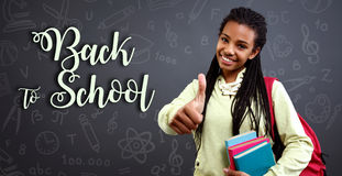 Schoolgirl is ready for future. Smiling schoolgirl is ready for future Royalty Free Stock Images
