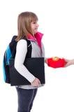 Schoolgirl receiving food box Stock Photo