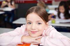 Schoolgirl Resting Chin On Hands In Classroom Royalty Free Stock Image