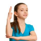 Schoolgirl with a risen hand Stock Image