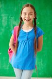 Schoolgirl with rucksack Royalty Free Stock Photography