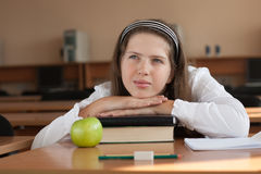 Schoolgirl's portrait at school desk Royalty Free Stock Photo