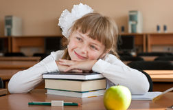 Schoolgirl's portrait at school desk Royalty Free Stock Photo