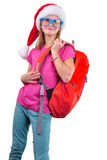 Schoolgirl with Santa Claus red hat, backpack and glasses Stock Photo