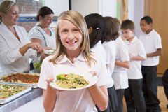 Schoolgirl in a school cafeteria Stock Images