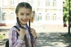 Schoolgirl with a schoolbag Stock Photos